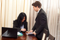 Laughing business people signing papers Royalty Free Stock Photos