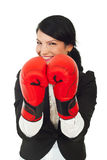 Laughing business woman with boxing gloves Royalty Free Stock Photos