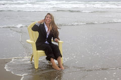 Laughing Business Woman In Chair In Ocean Royalty Free Stock Photo