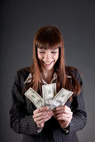Laughing business woman with dollars Royalty Free Stock Photo