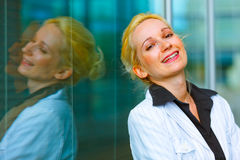 Laughing business woman standing at office Royalty Free Stock Images