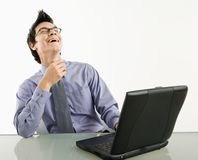 Laughing businessman on laptop. Stock Photo
