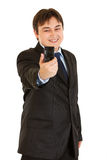 Laughing businessman photographing himself Stock Photos