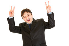 Laughing businessman showing victory gesture Stock Images