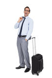Laughing businessman standing next to his suitcase Royalty Free Stock Photo