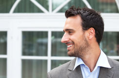 Laughing businessman in a suit looks to the left Stock Photography