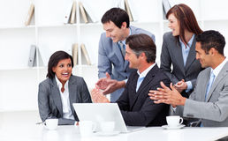 Laughing businesswoman applauded by her team Royalty Free Stock Photography