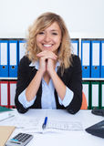 Laughing businesswoman with curly blond hair Royalty Free Stock Photography