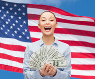 Laughing businesswoman with dollar cash money Stock Image