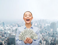 Laughing businesswoman with dollar cash money Stock Images