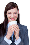 Laughing businesswoman drinking a coffee Royalty Free Stock Image