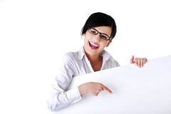 Laughing businesswoman with empty white banner Royalty Free Stock Images
