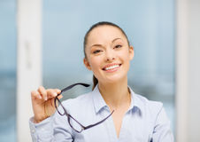 Laughing businesswoman with glasses Stock Image