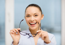 Laughing businesswoman with glasses Royalty Free Stock Photography