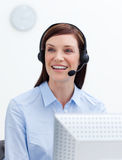 Laughing businesswoman with headset on Royalty Free Stock Photo