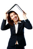 Laughing businesswoman holding a laptop above her head like a roof Stock Image