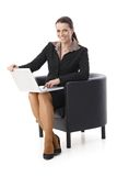 Laughing businesswoman with laptop Stock Photos