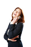 Laughing businesswoman talking on the phone Stock Photos