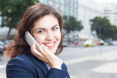 Laughing businesswoman talking at phone in the city Royalty Free Stock Photography