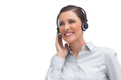 Laughing call centre agent wearing headset Stock Photography