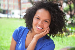 Laughing caribbean girl in a blue shirt Royalty Free Stock Photo
