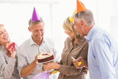 Laughing casual business people celebrating birthday Royalty Free Stock Image