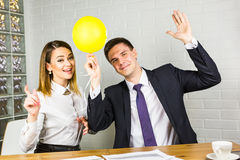 Laughing casual business people and holiday in the office.  royalty free stock image