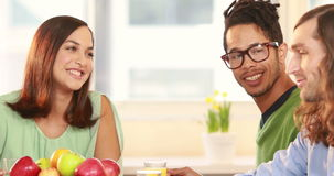Laughing casual business team having lunch together stock footage