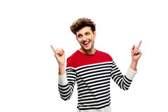 Laughing casual man pointing upwards Stock Images