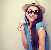Laughing casual woman in sunglasses and fashion summer hat. Vint Royalty Free Stock Photos