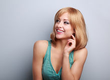 Laughing casual young blond woman looking up. Closeup portrait Stock Photography