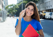 Laughing caucasian female student at phone Royalty Free Stock Photography