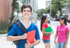 Laughing caucasian male student with friends Stock Images