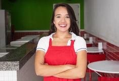 Laughing caucasian waitress in a fast food restaurant. Laughing caucasian waitress looking at camera in a fast food restaurant Stock Images