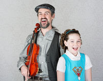 Laughing Celtic Fiddler and Girl Royalty Free Stock Photos