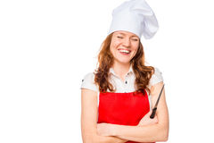 Laughing chef in red apron with a sharp knife Stock Photos