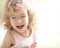 Laughing child. Shallow depth of fields stock photos