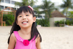 Laughing child. Portrait of a happy child girl at beach Royalty Free Stock Photo