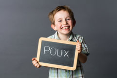 Laughing child advertising against French 'poux' or head lice Stock Image