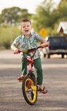 Laughing Child on Bike Royalty Free Stock Image