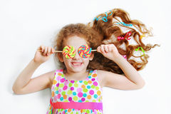 Laughing child with candy lollipop eyes in white background. Royalty Free Stock Images