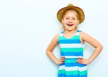 Laughing child girl portrait on white background. yelow hat. Fashion style posing Stock Images