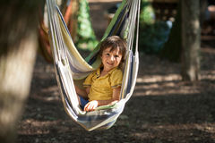 Laughing child in hammock Stock Photo