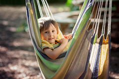 Laughing child in hammock Stock Photography