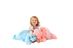 Laughing child holding toy poodles Stock Images