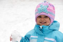 Laughing Child Keeping Snowball. Laughing Child Girl Keeping Snowball in Hand Royalty Free Stock Photo