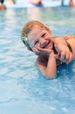 Laughing child lying in the shallow water Royalty Free Stock Photo
