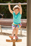 Laughing child  at  in sunny summer day Royalty Free Stock Image