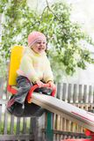 Laughing child on swing Royalty Free Stock Photo