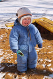 Laughing child in winter clothes Stock Photo